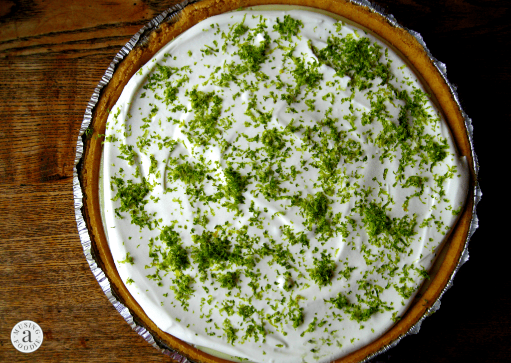 Homemade key lime pie in a graham cracker crust with fresh lime zest.