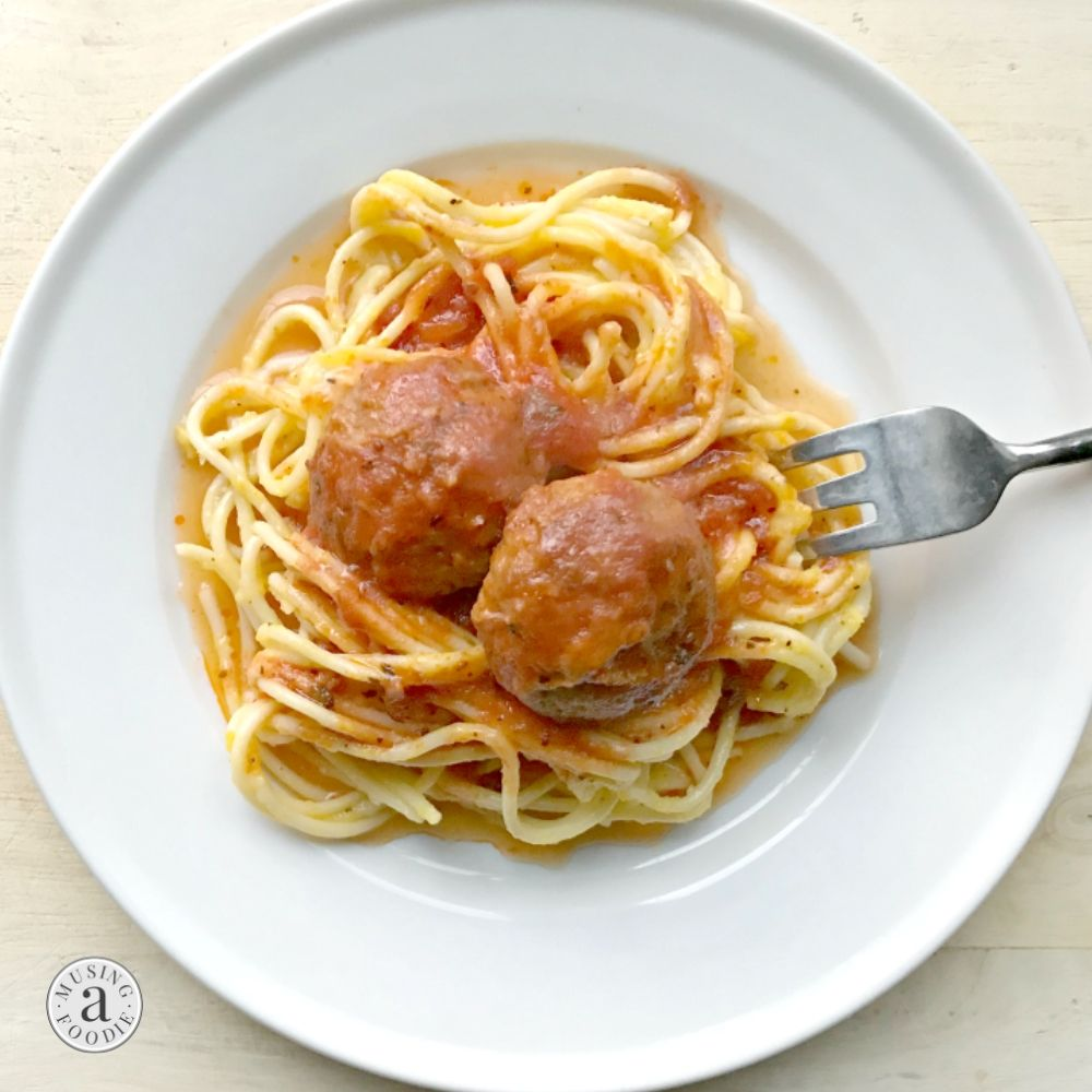 Spaghetti with easy homemade meatballs on a plate.