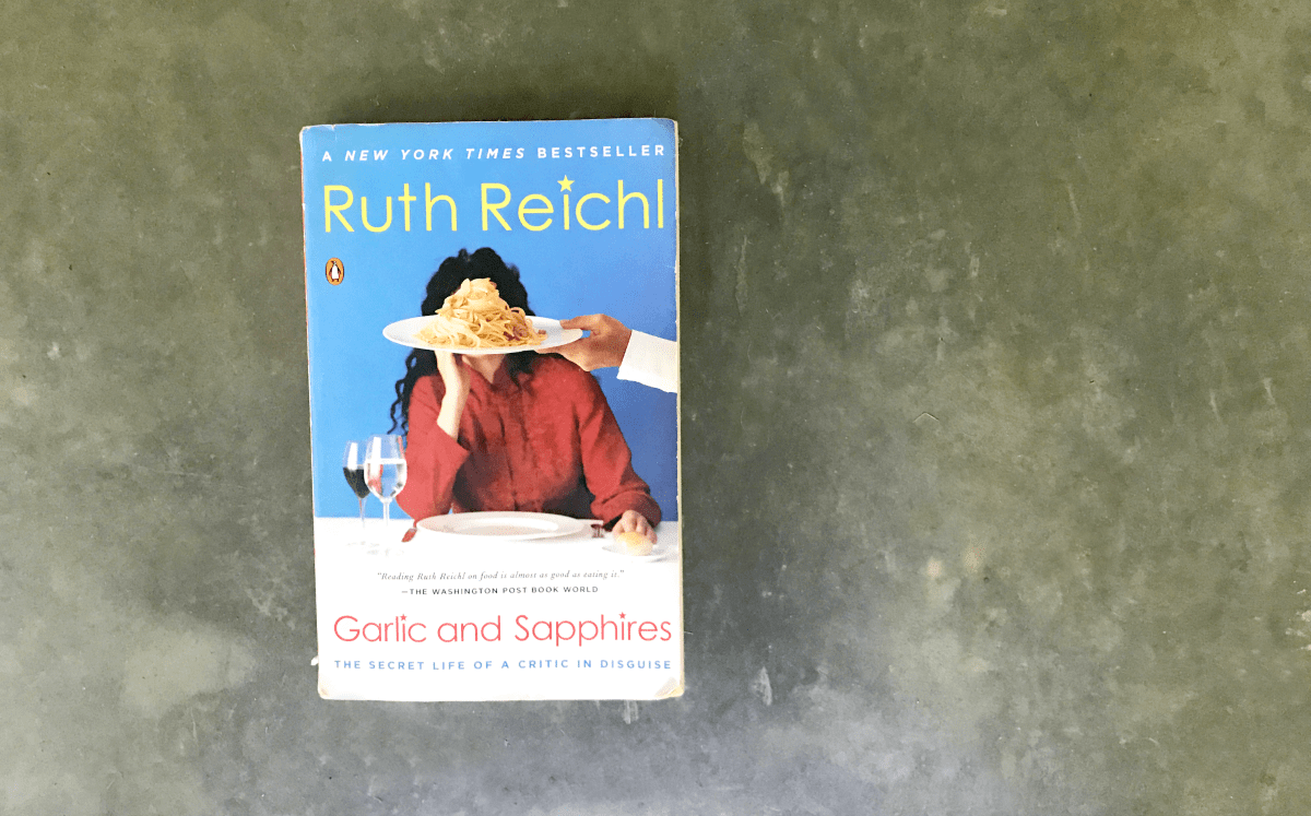 "During vacation season, reading becomes a front-and-center activity as toes are dipped in sand, lazy Sundays on the back porch abound, and the fast-paced school year has come to an end. I'm sharing one of my favorite books you should add to your collection: ""Garlic and Sapphires,"" by Ruth Reichl."