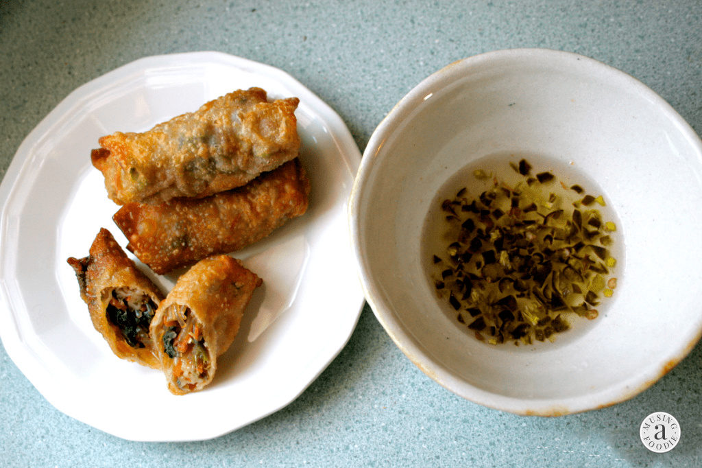 Homemade vegetarian spring rolls with crispy wonton wrappers and a savory vegetable filling with dipping sauce.