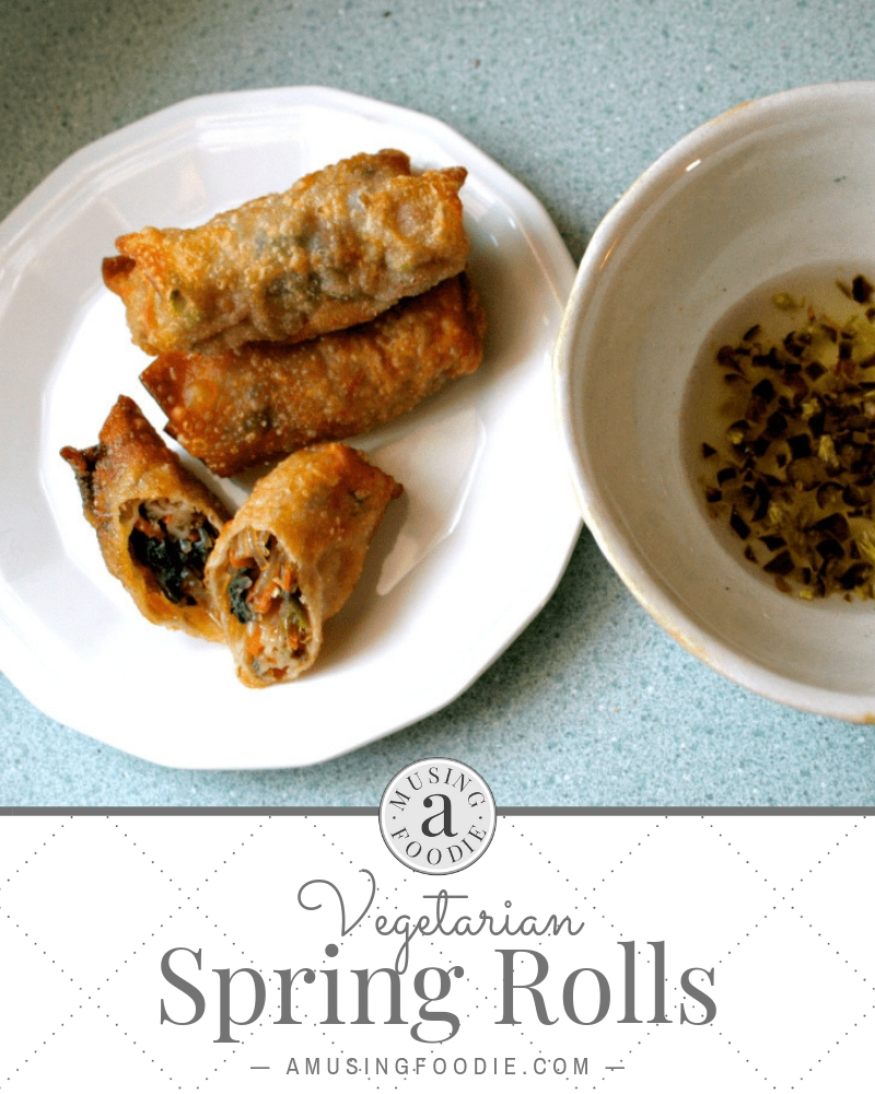 Make these homemade vegetarian spring rolls with crispy wonton wrappers and a savory vegetable filling and dipping sauce.