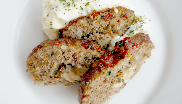 I happen to love a good meatloaf, especially with mashed potatoes and maybe some gravy.... YUM! Here's the recipe that your grandma probably didn't make (not that I'm sayin' Grandma's meatloaf was the dry slab I mentioned earlier, but there has to be a reason so many people hate it). I think it's time you revisit this retro dinner entrée!