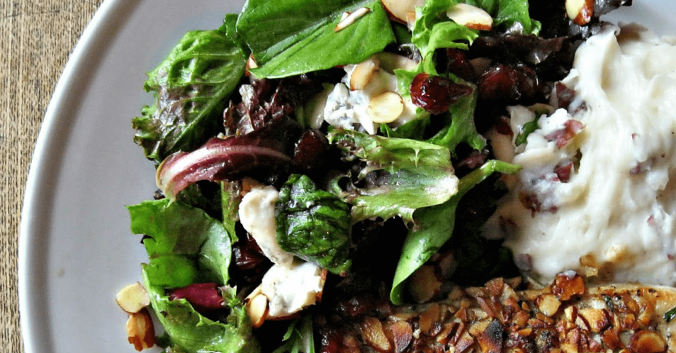 This simple field green salad, dressed with a Dijon balsamic and loaded with creamy Gorgonzola, tart cranberries and crunchy sliced almonds, makes for a perfect side salad or main course meal!
