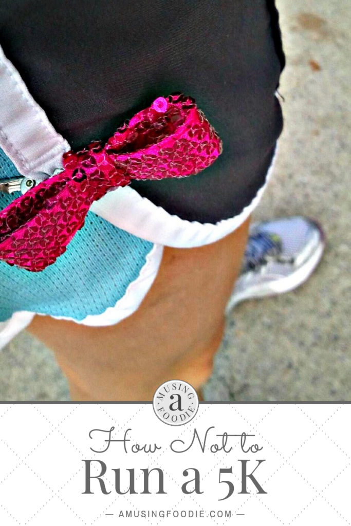 Bow pin from the Pink Ribbon 5K attached to running shorts.