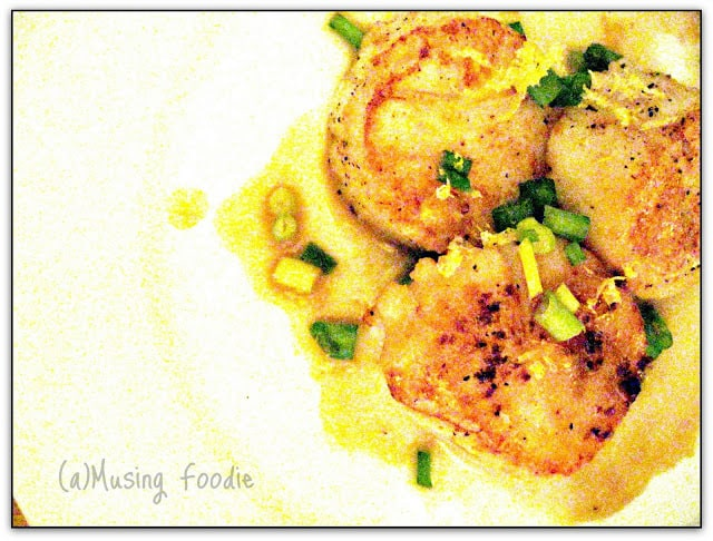 Pan-seared scallops on a plate.
