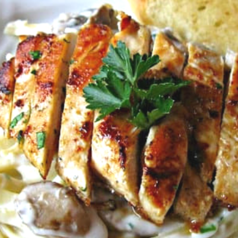 This simple chicken mushroom fettuccine alfredo is topped with a perfectly seasoned and seared chicken breast.