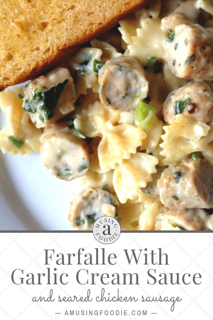 Save this recipe for farfalle with garlic cream sauce and seared chicken sausage.