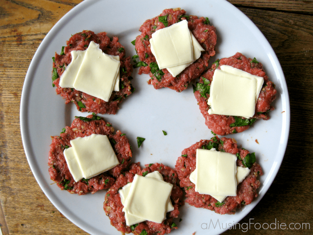 Cheese stuffed sliders are an easy alternative to a traditional cheeseburger!