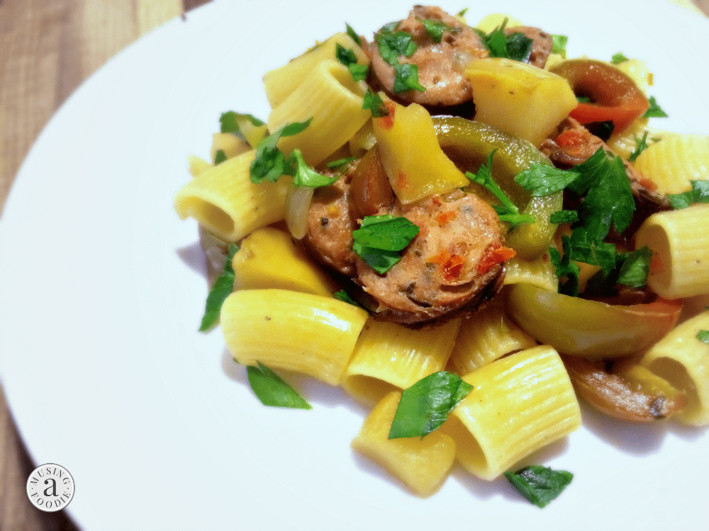 Plate of chicken sausage and apple rigatoni, ready in under thirty minutes.