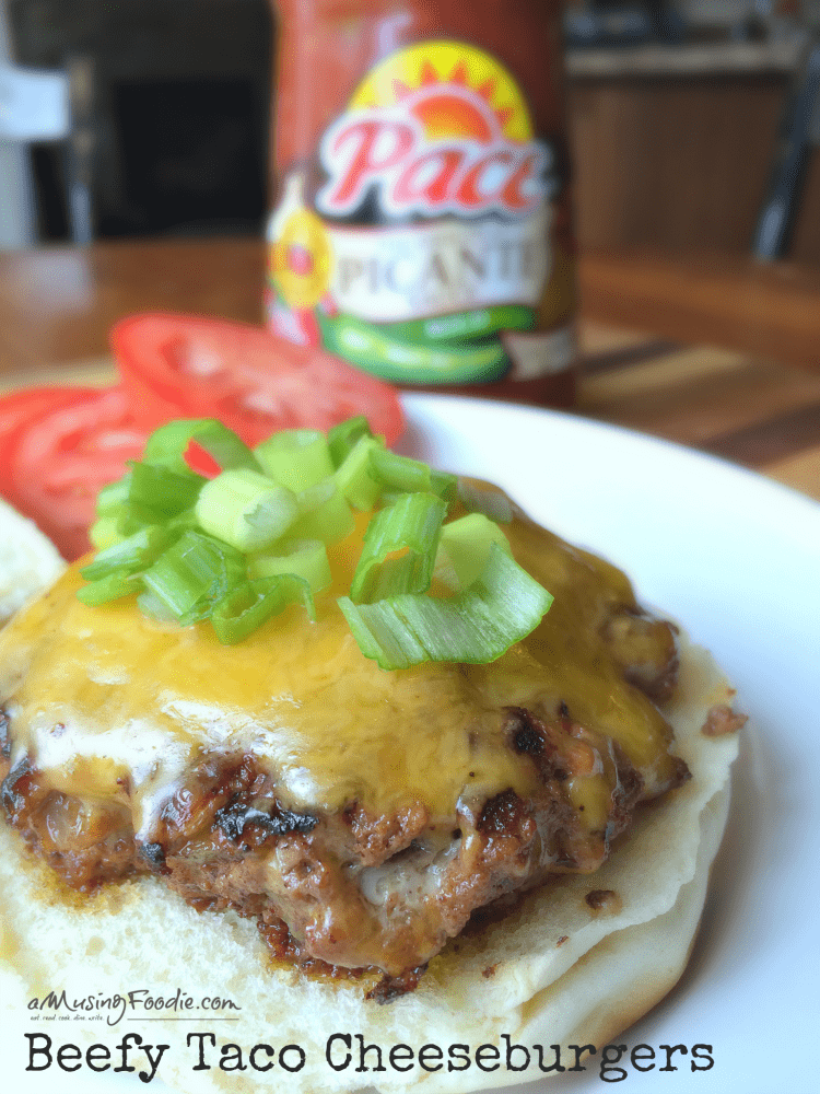 Beef taco cheeseburger on a plate.