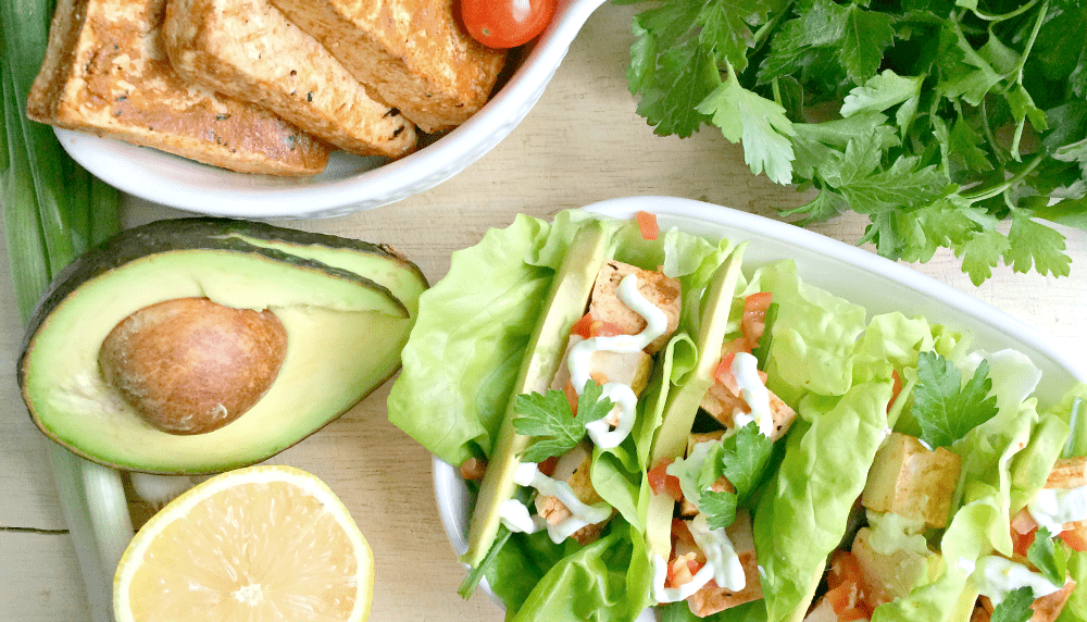 These vegetarian chipotle lettuce wraps are super easy to make and the lemon sour cream sauce is the perfect simple topper!