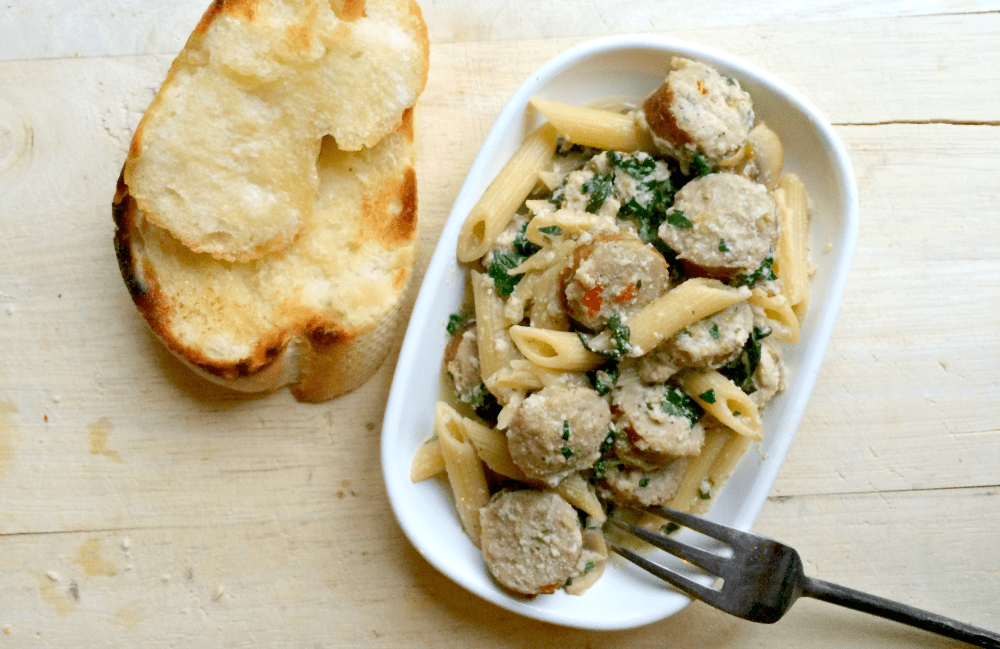 Creamy Penne With Seared Chicken Sausage: easy weeknight pasta dish full of mushrooms, spinach, onions and a savory creamy chicken sauce using ricotta!