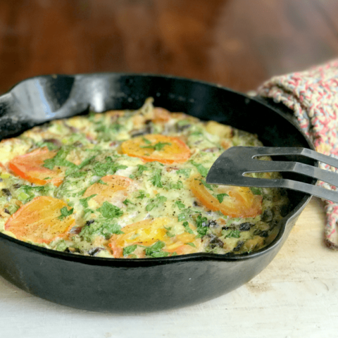 This savory crustless quiche for two is perfect for brunch (or dinner)! It's simply made, with Nellie's® Free Range Eggs, two kinds of cheddar from the Cabot® Creamery co-op of Vermont farm families, bacon, parsley and an assortment of veggies—including organic mushrooms, green onions and ripe heirloom tomatoes from the garden (or from your local farmers' market).