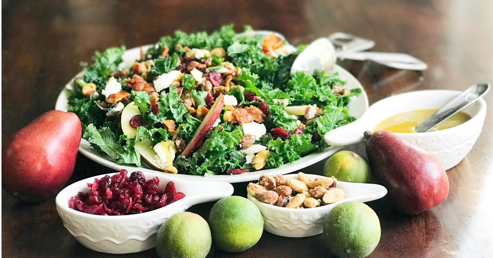 This kale salad is topped with Sahale Snacks Honey Almonds Glazed Mix, full of dried cranberries, sliced red pears, crispy bacon, honey goat cheese and a hint of lime juice. A simple homemade honey mustard dressing drizzled on top adds a final sweet and savory note. Yum!