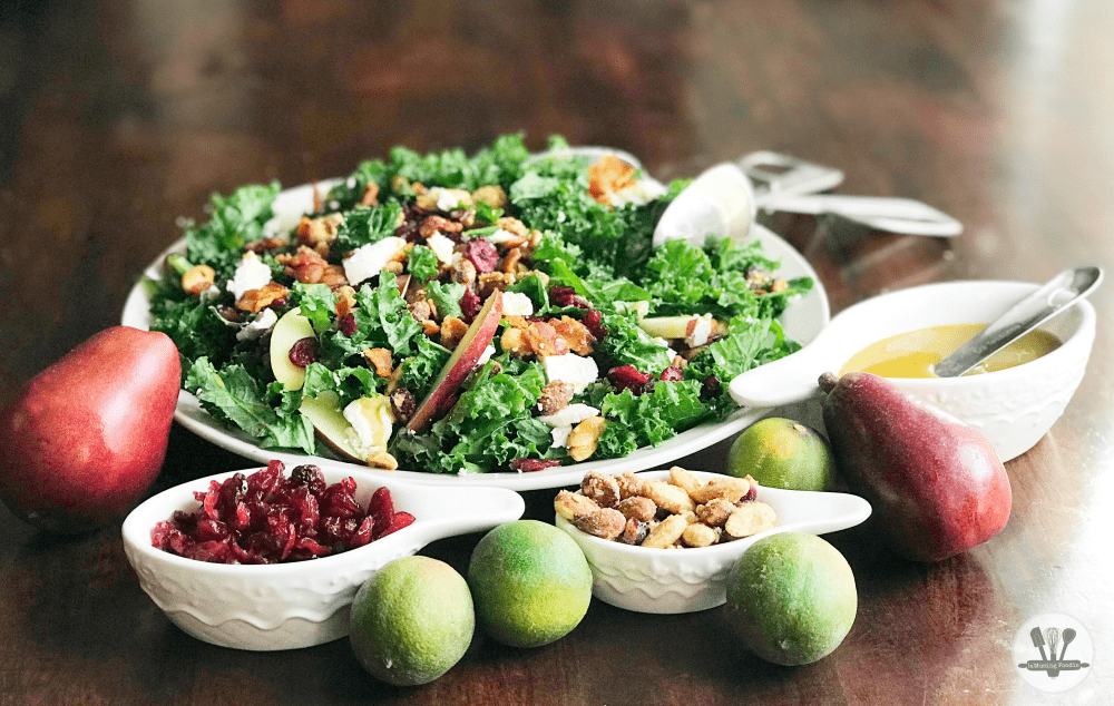 This fall kale salad is topped with Sahale Snacks Honey Almonds Glazed Mix, full of dried cranberries, sliced red pears, crispy bacon, honey goat cheese and a hint of lime juice. A simple homemade honey mustard dressing drizzled on top adds a final sweet and savory note. Yum!