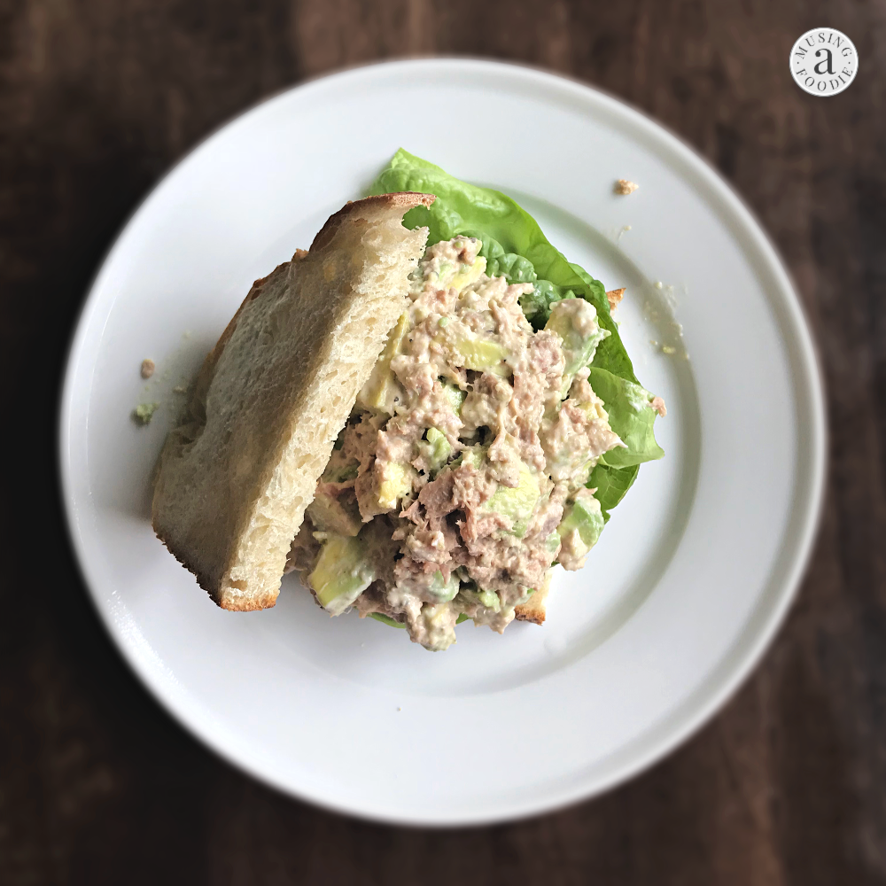 This avocado tuna salad is creamy and delicious, with just the right amount of salt and tang. Perfect eaten on toasted sour dough bread or atop a piece of butter lettuce!