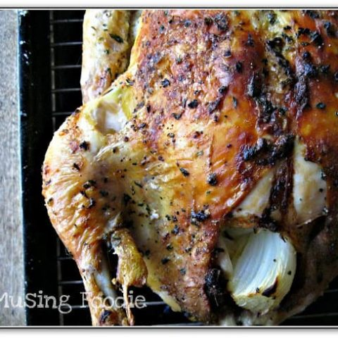 Weeknight Roast Chicken Stuffed With Clementines, Garlic and Onions