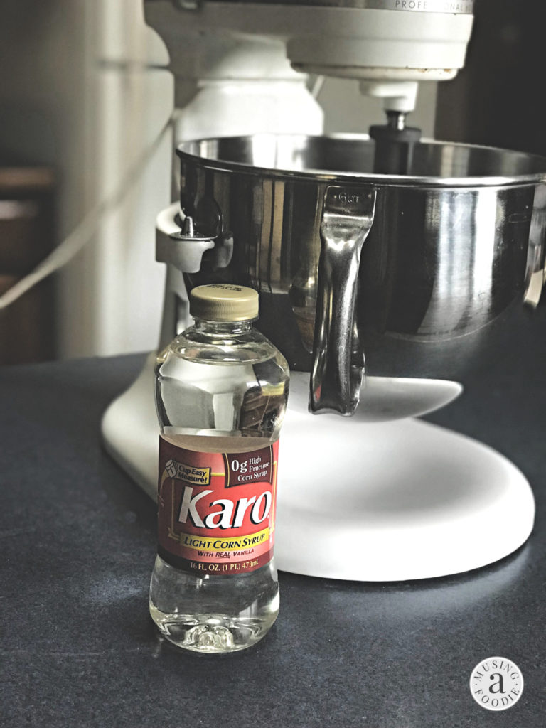 Karo® Corn Syrup next to a stand mixer.