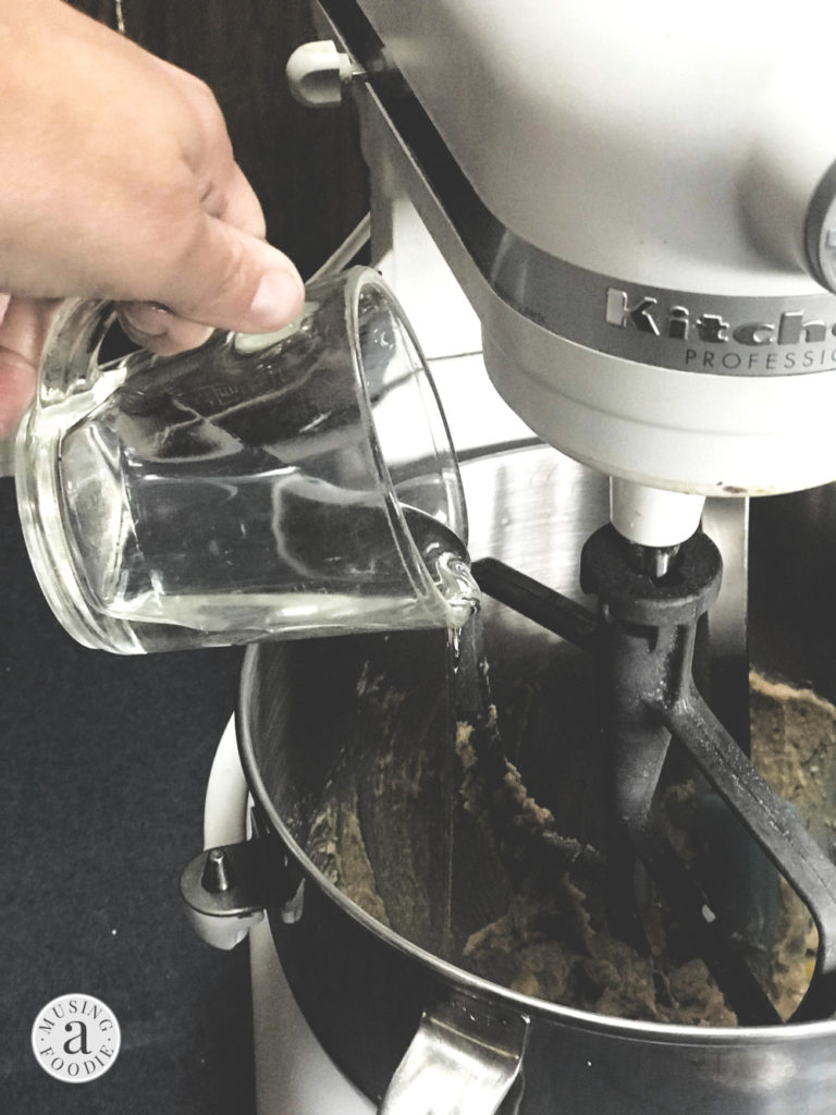 Karo® Corn Syrup being poured into the bowl of a stand mixer.