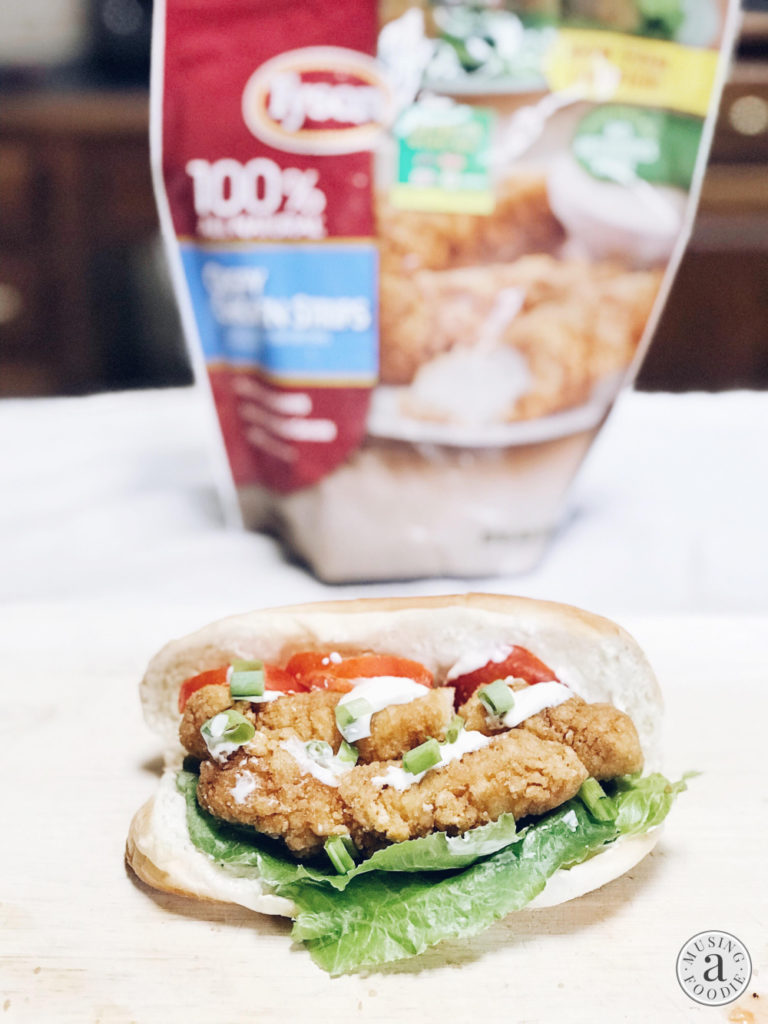 Tyson Crispy Chicken Strips layered on a sub roll with a lemon mayo sauce, lettuce, tomato and green onion.