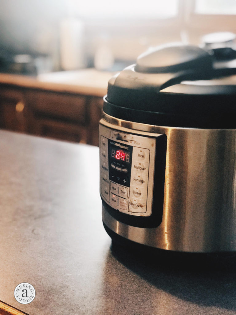 Electric pressure cooker beginning the countdown after coming to pressure.