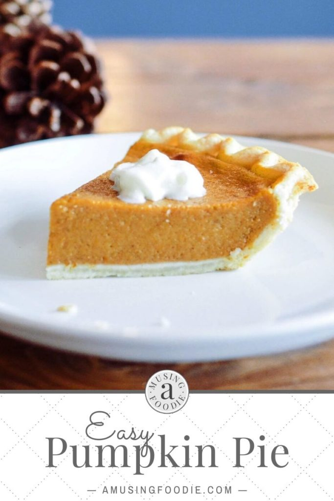 Slice of pumpkin pie with whipped cream on top.