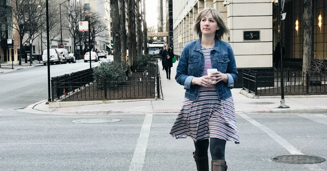 Liza walking down the street in Chicago